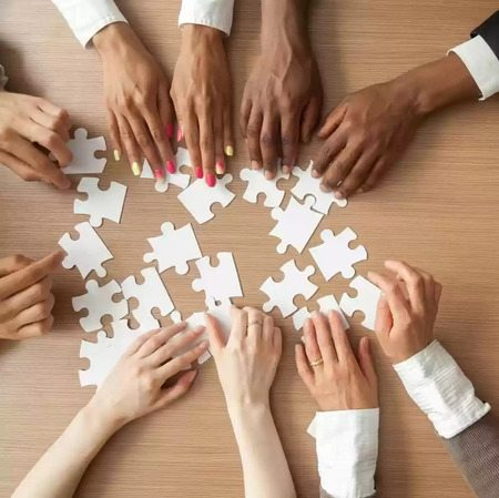 multi-touch attribution photo of hands piecing together an attribution puzzle - brightedge