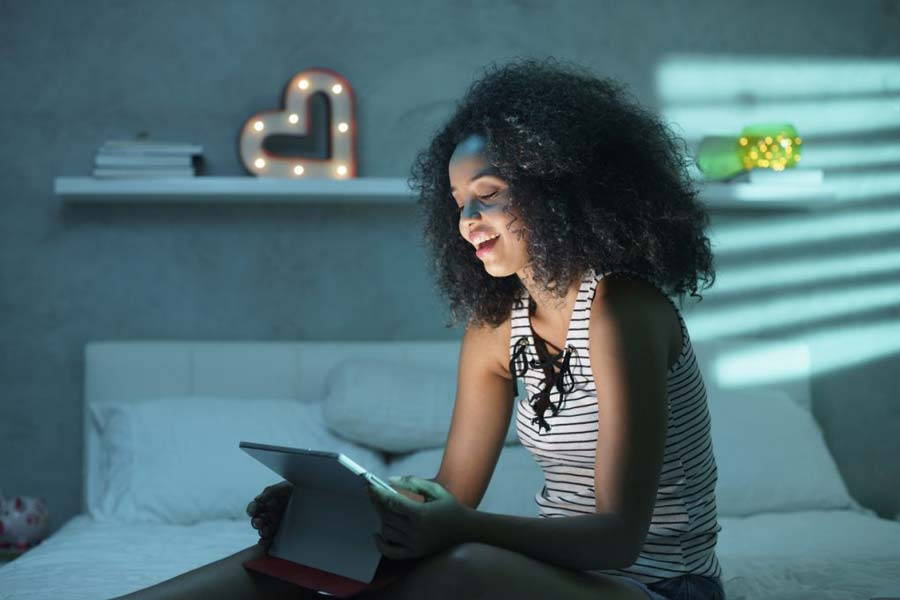 Woman watching mobile video, demonstrating importance of video strategy